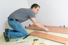 Laying laminate floor Royalty Free Stock Image