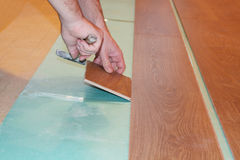 Laying laminate flooring Royalty Free Stock Images