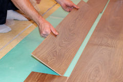 Laying laminate flooring Royalty Free Stock Image