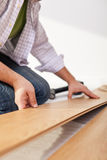 Laying laminate flooring - closeup Royalty Free Stock Images