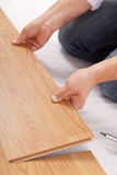 Laying laminate flooring - closeup royalty free stock photo
