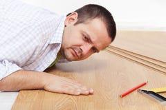 Laying laminate flooring at home Stock Photo