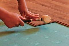 Laying laminate flooring Royalty Free Stock Photo