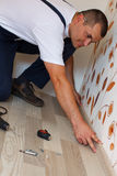 Laying laminate flooring in a home. Royalty Free Stock Image