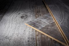 Laying laminate flooring. Laminate sheets on the floor royalty free stock photos