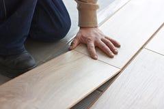 Laying laminate flooring Royalty Free Stock Images