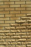 Wall of light smooth and uneven bricks. Laying of light smooth and uneven brick in the wall of the house, vertical shot stock photo