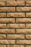 Wall of light uneven brick. Laying of light uneven brick in the wall of the house, vertical shot royalty free stock photos