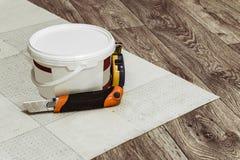 Laying linoleum flooring Stock Photo