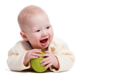 Laying little boy with apple Stock Photos