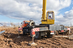 Laying of the main pipeline in the field using a crane Royalty Free Stock Photography