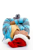 Laying man with christmas hat and ear phones Stock Photo