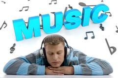 Laying man enjoying music Stock Photo