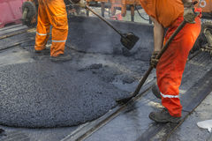 Laying of mastic surface Stock Photo