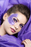 Laying model on purple fabric Royalty Free Stock Photography