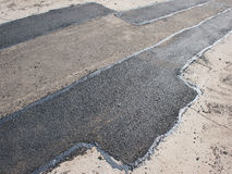 Laying new asphalt patching method Royalty Free Stock Photos