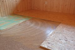 Laying of new parquet flooring in progress. Adhesive primer spread on old floor. Professional work, home improvement and renovation, carpentry and parquetry Royalty Free Stock Photography
