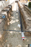 Laying new pipes in trench Stock Image