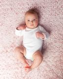 Laying newborn baby girl stock image