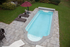 Laying old paving around a swimming pool Royalty Free Stock Photo