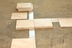 Laying out ceramic tile flooring Stock Photos