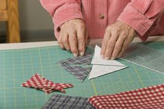 Laying out cut fabric Stock Image