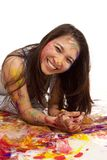 Laying in paint smile Royalty Free Stock Photo