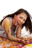Laying in paint very happy Royalty Free Stock Image