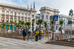 Laying of palm trees in Duomo square Cathedral Square, opposite the cathedral Duomo of Milan, Milan, Italy Stock Photos