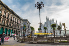 Laying of palm trees in Duomo square - Cathedral Square, opposite the cathedral Duomo of Milan, Milan, Italy Stock Images