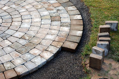 Laying patio bricks Royalty Free Stock Image