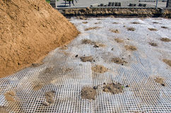 Laying pavement and street asphalt at summer. Preparation for laying pavement street asphalt with plastic net in square Stock Photos