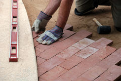 Laying pavers. Paving a home garden path Stock Photos