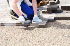 Laying pavers! Stock Image