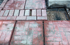 Laying of paving slabs on cement Royalty Free Stock Image