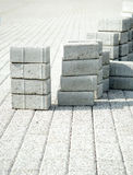 Laying paving slabs of gray in the towns pedestrian zone Royalty Free Stock Images