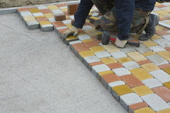 Laying Paving Slabs by mosaic close-up. Road Paving, constructio Royalty Free Stock Images