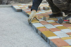 Laying Paving Slabs by mosaic close-up. Road Paving, constructio Royalty Free Stock Image