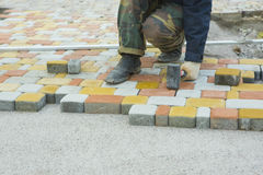 Laying Paving Slabs by mosaic close-up. Road Paving, constructio Royalty Free Stock Photography