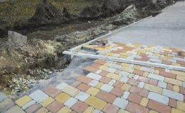 Laying Paving Slabs by mosaic close-up. Road Paving, constructio Royalty Free Stock Photo