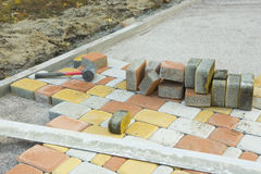 Laying Paving Slabs by mosaic close-up. Road Paving, constructio Stock Image