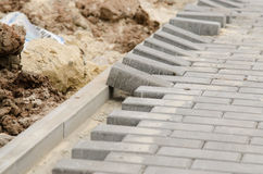 Laying of paving slabs to curb Royalty Free Stock Photo