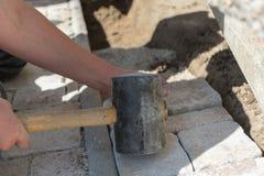 Laying paving stones Stock Photos