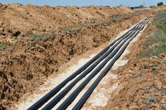Laying pipelines in a special corrosion-resistant insulation in royalty free stock image