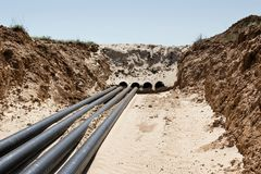 Laying pipelines in a special corrosion-resistant insulation in stock photo
