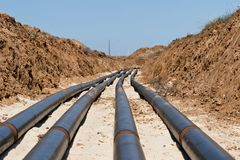 Laying pipelines in a special corrosion-resistant insulation in royalty free stock photos