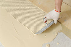 Laying plywood on the floor. Royalty Free Stock Photography