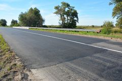 Laying and repair new asphalt road. royalty free stock images