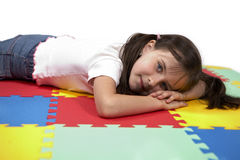 Laying on rubber foam carpet Royalty Free Stock Image