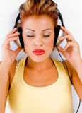 Laying sexy model with headphone Stock Images